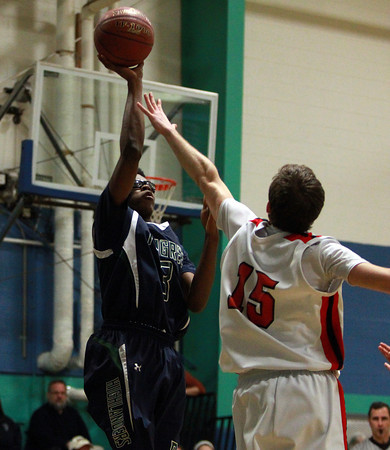 Pingree sophomore Alonzo Jackson (3) hits a one handed floater over PCD's Alex Minetti (15) on Wednesday evening. DAVID LE/Staff Photo 2/26/14