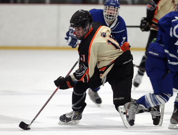 Beverly senior forward Ryan Santo (11) carries the puck through the Panthers offensive zone during the third period of play on Friday evening. DAVID LE/Staff Photo 2/28/14