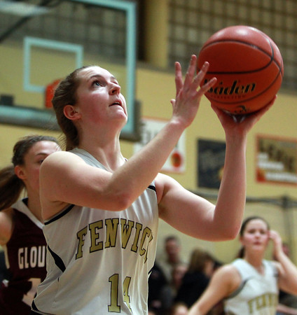 Bishop Fenwick senior captain Bridget Corcoran (14) soars in for an easy layup against Gloucester on Thursday evening. DAVID LE/Staff photo