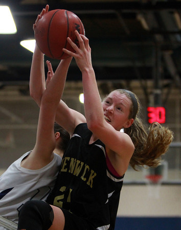 Bishop Fenwick sophomore Colleen Corcoran (24) wrestles away a rebound from Hamilton-Wenham sophomore Molly Eagar on Tuesday evening. DAVID LE/Staff Photo 2/18/14