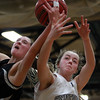 Bishop Fenwick freshman forward Mikayla Porcaro, left, battles for a rebound with Hamilton-Wenham freshman Kelly Walsh, right, during the championship game of the General Patton Tournament on Tuesday evening. DAVID LE/Staff Photo 2/18/14