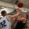 Marblehead senior guard Matt Millett (2) loses control of the ball after getting his shot blocked by Danvers junior center Peter Merry (32) on Wednesday evening. DAVID LE/Staff Photo 2/26/14