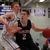 Marblehead senior Matt Millett (2) tries to drive to the hoop while being tightly defended by Danvers senior Keiran Beck (12) on Wednesday evening. DAVID LE/Staff Photo 2/26/14