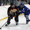 Beverly senior forward Kevin Lally (3) controls the puck behind the Danvers net while being pursued by Falcon senior defenseman Alec Littlefield (9) on Friday evening. DAVID LE/Staff Photo 2/28/14