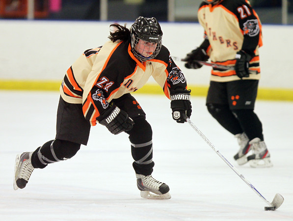 Beverly junior defenseman Caitlin McBride (20) carries the puck up ice against Chelmsford on Wednesday evening. DAVID LE/Staff Photo 2/19/14