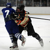 Beverly junior defenseman Nick Albano (8) steps up and makes a huge hit on Danvers junior forward Ryan Buchanan (7), separating him from the puck during the third period of play on Friday evening. DAVID LE/Staff Photo 2/28/14
