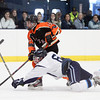 Beverly junior forward Jesse McLaughlin (15) manages to fire a shot on net before being wiped out by diving Peabody defenseman Donny Shaw (6) during the third period of play on Monday afternoon. DAVID LE/Staff Photo 2/17/14