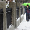 Ken Yuszkus/Staff photo: Salem:  Dr. Julie Breskin of Salem walks along North Washington Square under her umbrella in the snow/rain mix on her way to work.