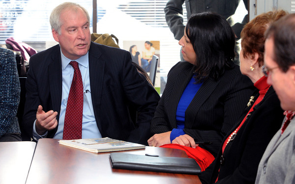 Ken Yuszkus/Staff photo: Salem:  Federal Reserve Bank president Eric Rosengren speaks as Salem Mayor Kim Driscoll listens during a roundtable discussion before the walking tour of the Point neighborhood Tuesday morning.
