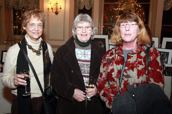 From left, Karen Hosking, of Salem, Peggy Farrall, of Marblehead, and Monique Luijben, of Salem, at the 4th Annual Artists & Authors Winter Exhibition held at the Hawthorne Hotel on Wednesday evening. DAVID LE/Staff Photo 2/19/14