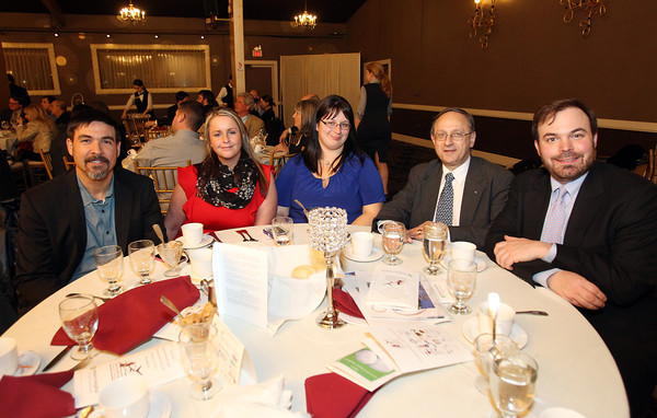 From left, Chris Meusel, Linda Montenero, Amy Patten, John Maihos, and Garrett Miller, of Blue Vase Marketing LLC, at the Third Annual Business Awards hosted by the Greater Beverly Chamber of Commerce at the Danversport Yacht Club on Thursday evening. DAVID LE/Staff Photo 2/27/14