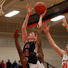 North Andover junior Spencer Reeve (32) soars in for a layup after beating Beverly senior Nick Cross (24) off the dribble on Tuesday evening. DAVID LE/Staff photo 2/25/14