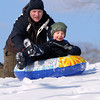 Ken Yuszkus/Staff photo: Beverly:  William Gavenas, 4, of Beverly, gets a push from his father, Michael, as he slides down a hill at Dane Street Beach.