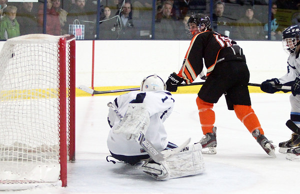 Beverly junior forward Clinton Cabral (19) watches his backhanded shot sail past Peabody goalie Stephen Ferrante (1) for the Panthers' 8th and final goal of the game as Beverly captured the 27th Annual Carlin Cup with a 8-1 win over the Tanners at the McVann-O'Keefe Rink on Monday afternoon. DAVID LE/Staff Photo 2/17/14