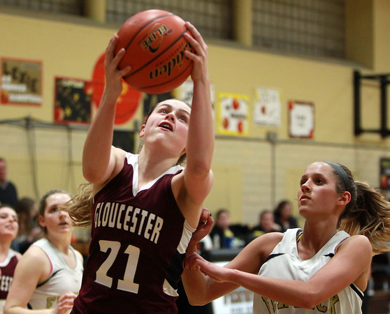 Gloucester's Emma Knowlton (21) grabs a rebound over Bishop Fenwick senior Kate Lipka (33) during the first half of play on Thursday evening. DAVID LE/Staff photo
