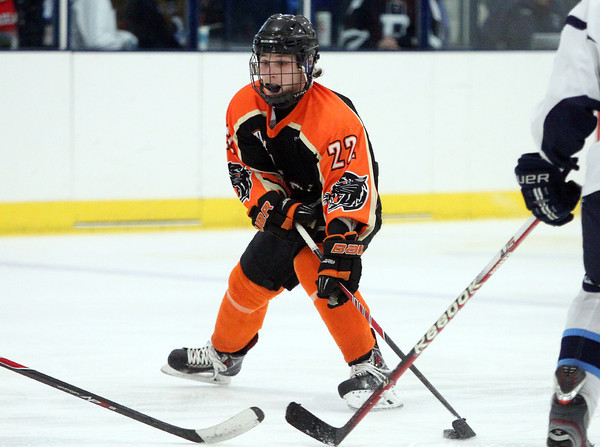 Beverly senior captain Connor Irving (22) dangles with the puck as he drives towards the net during the third period of play in the 27th Annual Carlin Cup against Peabody. DAVID LE/Staff Photo 2/17/14