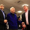 Legendary Swampscott High School coach and athletic director Dick Lynch, center, gazes up at the newly hung sign in his honor above the gymnasium door, while flanked by Jack Taymore of the Swampscott HOF Committee, left, and his son Mike Lynch, right, on Tuesday evening. DAVID LE/Staff photo