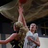 Hamilton-Wenham senior captain Sam Charette (35) makes a layup over the block attempt from Bishop Fenwick sophomore Colleen Corcoran (24) during the second half of play on Tuesday evening. DAVID LE/Staff Photo 2/18/14