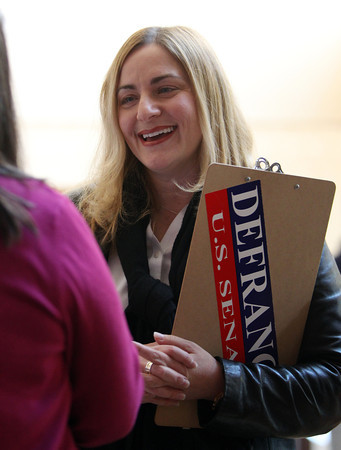 Congressional candidate Marisa DeFranco campaigns prior to the start of the Democratic Caucus held at Salem High School on Saturday morning. DAVID LE/Staff Photo 2/28/14