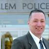 Ken Yuszkus/Staff photo: Salem:  Salem Police Chief Paul Tucker stands in front of the Salem Police Station.