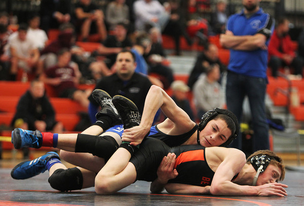 Beverly: Marblehead/Swampscott wrestler Stephen Hopkins, left, pins his opponent, Beverly's John Jones, against the mat during the NEC/CAL Tournament at Beverly High School on Saturday morning. DAVID LE/Staff Photo