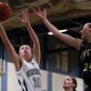 Hamilton-Wenham freshman Kelly Walsh (10) grabs a rebound over Bishop Fenwick sophomore Colleen Corcoran (24) on Tuesday evening in the Championship Game of the General Patton Tournament. DAVID LE/Staff Photo 2/18/14