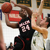 Salem guard Kelven Perpetuo (24) drives hard to the hoop while being defended by Lynn Classical's Strati Saranteas (4) on Friday evening. DAVID LE/Staff Photo 2/14/14