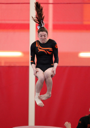 Beverly gymnast Hannah Rennie launches herself off the vault during the North Sectional Tournament held at Hudson High School on Saturday. DAVID LE/Staff Photo 2/22/14