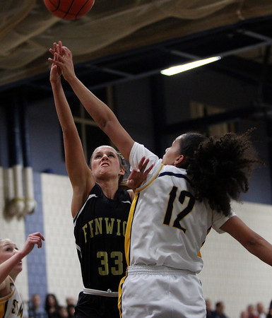 Bishop Fenwick senior captain Kate Lipka (33) gets a lay-up off while being fouled by St. Mary's senior Brianna Rudolph (12) during the first half of play in the D3 North semifinal at Hamilton-Wenham Regional High School on Tuesday evenin. DAVID LE/Staff photo