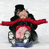 Sofia Meagher, of Beverly, holds her arms out wide while sledding down the hill at Lynch Park with her mother Julie Meagher, on Monday afternoon. DAVID LE/Staff photo