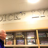 Legendary Swampscott High School coach and athletic director Dick Lynch, smiles as the sign over the renamed gymnasium in his honor is revealed at the new Swampscott High School on Tuesday evening. DAVID LE/Staff photo