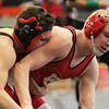 Beverly: Beverly's Jonah Feingold, left, grapples with Masco's Ty Cameron during the semi-final 120-lb match during the NEC/CAL Tournament at Beverly High School on Saturday morning. DAVID LE/Staff Photo