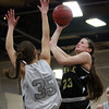 Bishop Fenwick senior Gianna Pizzano (23) drives to the hoop and lets go of a floater over Hamilton-Wenham senior Sam Charette (35). DAVID LE/Staff Photo 2/18/14