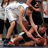 Marblehead junior guard Spenser Craig (3) tries to keep control of the ball after diving for a loose ball while Danvers junior center Peter Merry (32) tries to wrestle the ball away. DAVID LE/Staff Photo 2/26/14