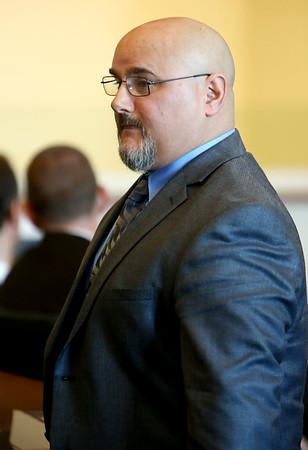 KEN YUSZKUS/Staff photo. Ipswich police Patrolman Peter Nikas was in Salem District Court on Friday morning.  02/06/15