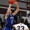 DAVID LE/Staff photo. 2/18/15. Danvers senior guard Vinny Clifford lines up a three-pointer during the first half of play on Wednesday evening at Lynn English High School. The Falcons pulled off a 79-78 last second win over the Bulldogs on a Devan Harris free throw after he was fouled on a last second attempt.