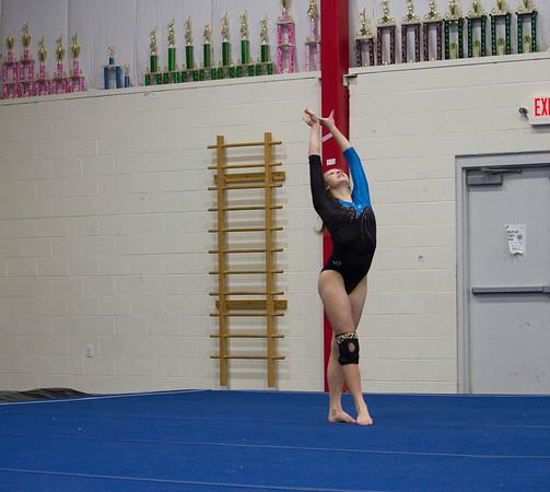 MARIA UMINSKI/SALEM NEWS Danvers junior Julia Valenti strikes a pose during her floor routine.