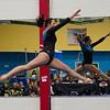 MARIA UMINSKI/SALEM NEWS Danvers/Reading senior Hannah Burns leaps through the air during her floor routine.