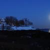 PAUL BILODEAU/Staff photo. The moon rises near Fort Sewall in Marblehead illuminating the ocean and cove.