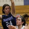 DAVID LE/Staff photo. Hamilton-Wenham sophomore Lauren Flynn (1) tries to spin past Swampscott freshman Faye Parker (24). 2/4/16.