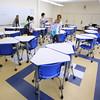 KEN YUSZKUS/Staff photo.     Students enter a newly renovated classroom at St. John's School.      2/4/16