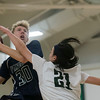 SAM GORESH/Staff photo. Pingree School's Jake Spaulding goes up for a basket as Concord Academy's Auden Gall attempts to block him on defense in their game at the Pingree School. 2/3/17