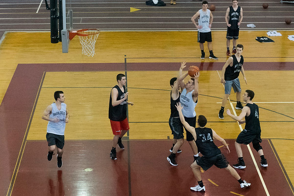 SAM GORESH/Staff photo. Marblehead' senior Bo Millett attempts to shoot the ball during the boys' basketball team practice at Marblehead High School. 2/12/17