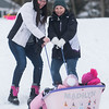 SAM GORESH/Staff photo. Sisters Cynthia Smith (left) and Jamie Giacchino (right) pull their daughters Madilyn Smith, 2, (right) and Adrianna Giacchino, 10, up the hill in a sled at Lyons Park. 2/12/17
