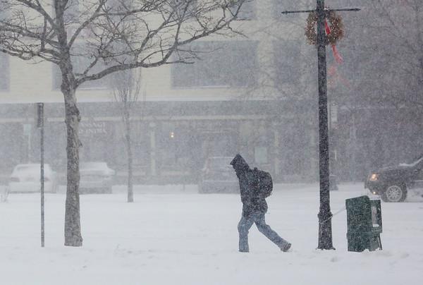 HADLEY GREEN/ Staff photo<br /> A man walks along Margin Street in Salem during Thursday's snowstorm.