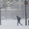 HADLEY GREEN/ Staff photo<br /> A man walks along Margin Street in Salem during Thursday's snowstorm.