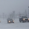 HADLEY GREEN/ Staff photo<br /> Cars stop at a red light on Washington Street in Salem during Thursday's snowstorm.