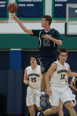 SAM GORESH/Staff photo. Pingree School's John Fay jumps to pas the ball in their game against Concord Academy at the Pingree School. Pingree won the game 68-19. 2/3/17
