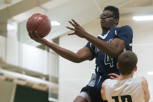 SAM GORESH/Staff photo. Pingree School's Alanzo Jackson prepares to shoot a basket in their game against Concord Academy at the Pingree School. Pingree won the game 68-19. 2/3/17