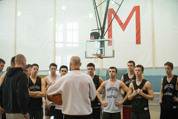 SAM GORESH/Staff photo. Marblehead boy's basketball team listens to head coach Mike Giardi during their practice at Marblehead High School. 2/12/17